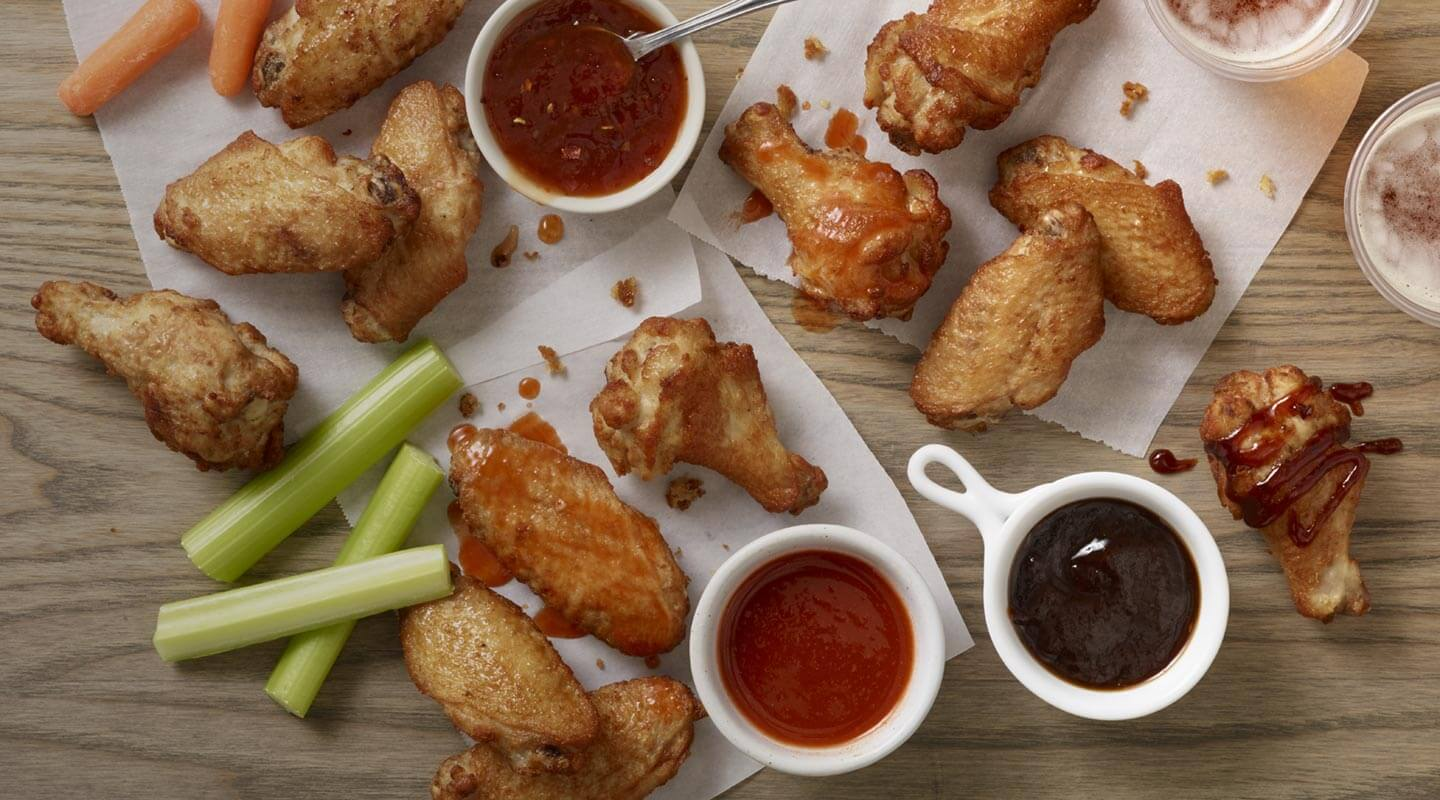 take out crispy wings on a table